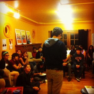 Student shares his work at open mic