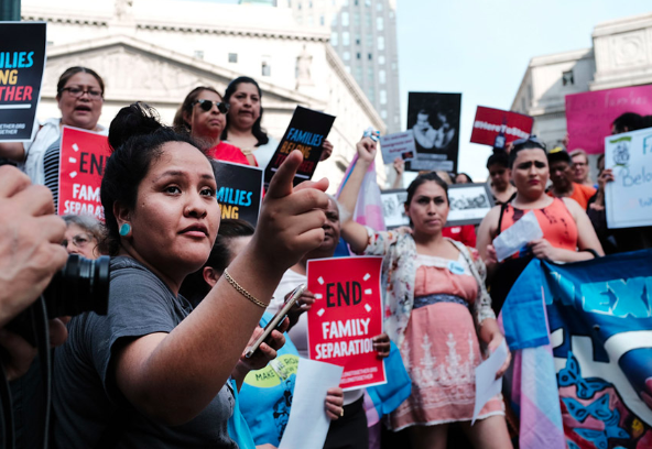 "Hundreds of immigrant rights activists participate in a rally at the Federal Building in lower Manhattan on June 1, 2018 in protest of the Trump administration's ""zero tolerance"" immigration policy. (Image credit: In These Times Magazine)"
