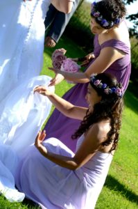 My sister and my friend graciously help me pick bugs out of my dress during my second, less-uncool wedding.